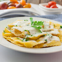 Homemade italian ravioli with sauce and parsley. Photo by trexec/iStockphoto.com