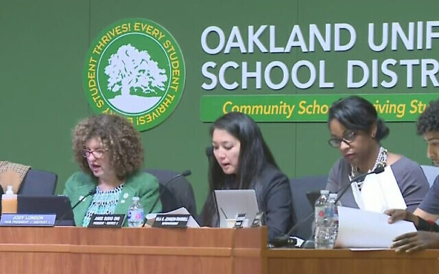 """An illustrative view of a school board meeting of the Oakland Unified School District. In May, the school board passed a resolution stating that it supports """"the California Ethnic Studies Model Curriculum Draft as written,"""" despite concerns over anti-Semitism. Screenshot from JNS."""