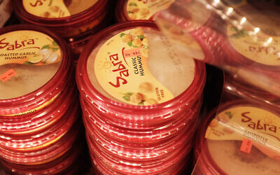 Cases of Sabra Classic Hummus are viewed on the shelf of a grocery store on April 9, 2015 in New York City. (JTA/Spencer Platt/Getty Images)