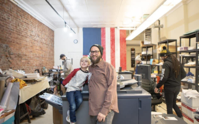 Josh Snider and his son Shark. Snider's printing business was helped with a loan from HFLA. (Photo provided by Josh Snider)