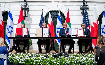 From left, Minister of Foreign Affairs of Bahrain Dr. Abdullatif bin Rashid Al-Zayani, Israeli Prime Minister Benjamin Netanyahu, President Donald J. Trump and Minister of Foreign Affairs for the United Arab Emirates Abdullah bin Zayed Al Nahyan sign the Abraham Accords Tuesday, Sept. 15, 2020, on the South Lawn of the White House. (Official White House Photo by Tia Dufour)