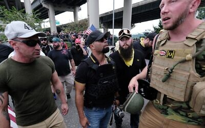Far-rightists from the Proud Boys wait to get into vehicles after marching across the Hawthorne Bridge in Portland, Ore., Aug. 17, 2019. (Alex Milan Tracy/Anadolu Agency via Getty Images via JTA)