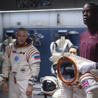 Ato Essandoh, right, as Kwesi Weisberg-Annan in Netflix's space drama 'Away.' Photo by Diyah Pera/Netflix via JTA