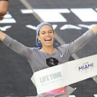 Beatie Deutsch crossing the finish line to win the women's category of the 2020 Miami half-marathon race. Photo by Marathon-Photos.