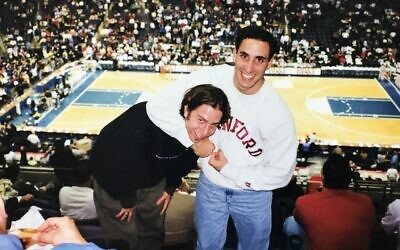 Mark Davidson, left, and Josh Green, enjoy a basketball game between alma matter rivals George Washington University and Stanford University. Photo circa 2000. Courtesy of Mark Davidson