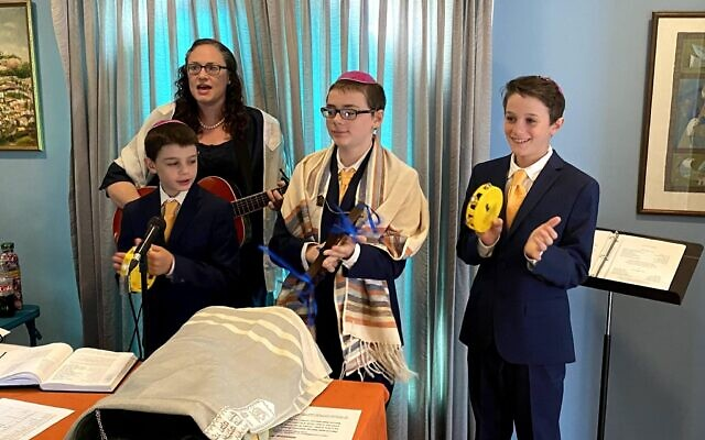 Rodef Shalom Congregation Cantorial Soloist Molly May sings along with her sons Andrew, David and Jesse. Photo courtesy of Molly May