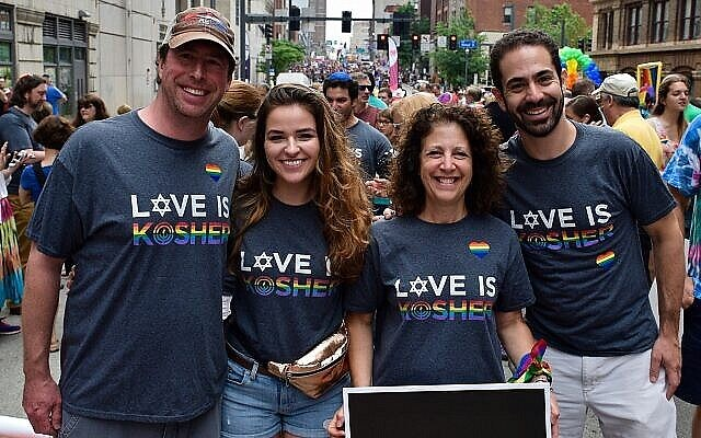 Bob Silverman and Cindy Goodman-Leib (shown here at  the 2018 EQT Equality March) have both volunteered time as leaders in the Pittsburgh Jewish community. From left Silverman, CRC Director Laura Cherner, Goodman-Leib and former CRC Director Josh Sayles.  Photo courtesy of the Jewish Federation of Greater Pittsburgh.