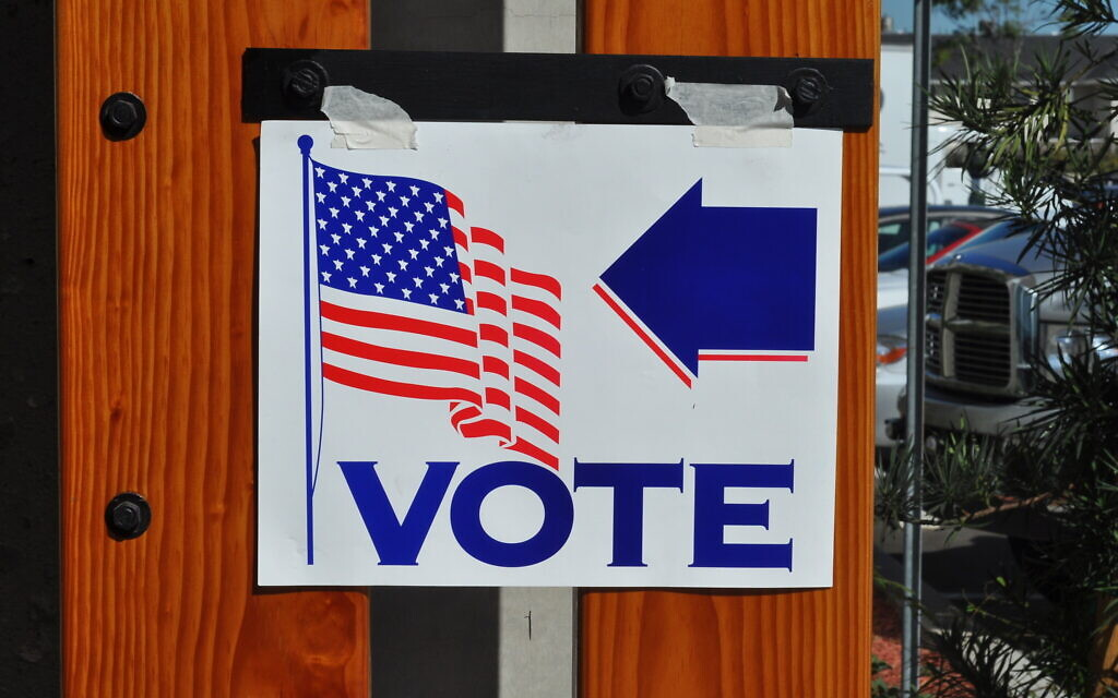 Voting sign in California in 2008. Photo https://commons.wikimedia.org/wiki/File:Voting_United_States.jpg by Tom Arthur flickr.com/people/59888866@N00 and licensed under the Creative Commons Attribution-Share Alike 2.0 Generic license https://creativecommons.org/licenses/by-sa/2.0/deed.en