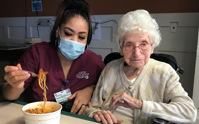 CNA Stacey Barnette and 102-year-old Toni enjoy lunch together. Photo courtesy of Jewish Association on Aging.