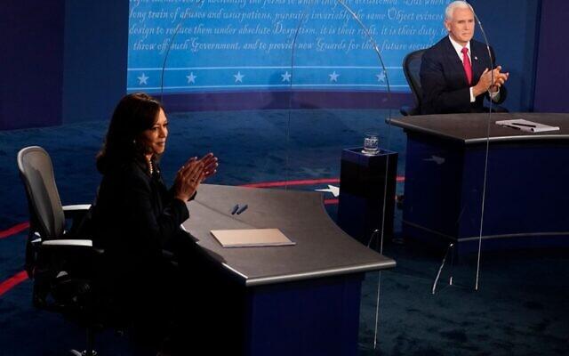 Democratic vice presidential nominee Sen. Kamala Harris (D-CA) and U.S. Vice President Mike Pence applaud after their debate at the University of Utah in Salt Lake City, Utah on October 7, 2020. (Morry Gash-Pool/Getty Images via JTA)