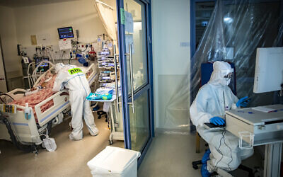 Workers at Shaare Zedek hospital in Jerusalem wear protective clothes as they work in the coronavirus ward, Oct. 1, 2020. (Nati Shohat/Flash90 via JTA)