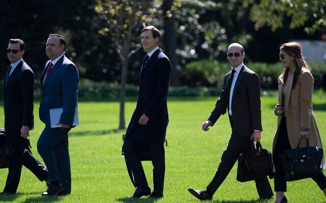 Jared Kushner (third from right), Stephen Miller (second from right) and Trump advisor Hope Hicks walk to Marine One on the White House lawn Sept. 30, 2020. Hicks began showing symptoms of COVID-19 that day. (Andrew Caballero-Reynolds/AFP via Getty Images via JTA)