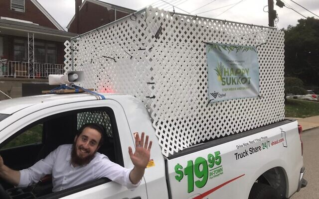 Rabbi Yitzi Goldwasser in his sukkahmobile  (Photo provided by Rabbi Yitzi Goldwasser)