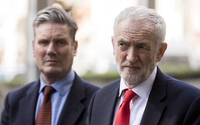 Former Labour leader Jeremy Corbyn, right, and his successor Keir Starmer talk to journalists in Brussels, Belgium, March 21, 2019. (Thierry Monasse/Getty Images via JTA)