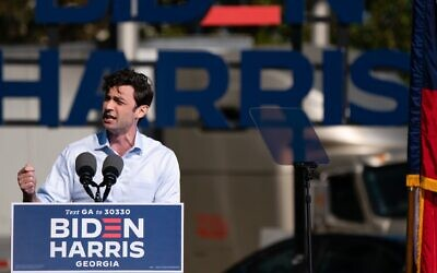 Democratic US Senate candidate Jon Ossoff speaks at a Get Out the Vote rally with former U.S. President Barack Obama as he campaigns for Democratic presidential candidate former Vice President Joe Biden in Atlanta on Nov. 2, 2020. (Elijah Nouvelage / AFP via Getty Images via JTA)