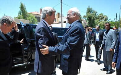 Saeb Erekat greets then-U.S. Secretary of State John Kerry before a meeting in Amman, Jordan, on June 28, 2013. (State Department Photo/Public Domain)