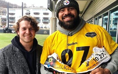 Cam Heyward with Cody Sabol, the nationally recognized speed painter from Pittsburgh who designed the cleats. (Photo provided by Larry Ceisler / Ceisler Media)