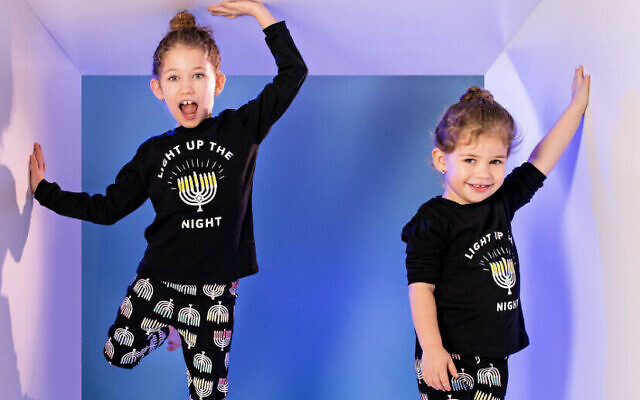 Lighting up the night in Levenson's glow-in-the-dark Chanukah PJs (Photo from Shprinzy Friedman Photography)