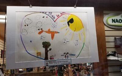 Artwork displayed in Little's Shoes store window. (Photo by Larry Ceisler)