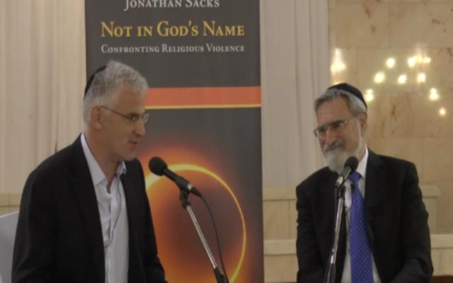 Daniel Taub (left) interviewing Rabbi Lord Jonathan Sacks (Photo via jewishnews.timesofisrael.com)