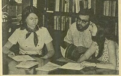 A photograph from the Aug. 6, 1970, issue of the Jewish Chronicle, showing graduate students creating an inventory of historic records at Temple Sinai.