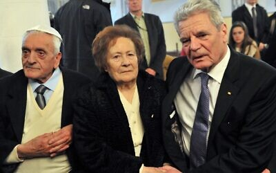 Esther Cohen shakes hands with then-German President Joachim Gauck, right, during a visit of the synagogue in Ioannina, Greece, March 7, 2014. (Sakis Mitrolidis/AFP via Getty Images via JTA)