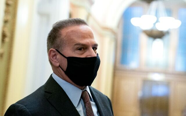 Rep. David Cicilline (D-RI) wears a protective mask while speaking to reporters at the U.S. Capitol in Washington, DC on Jan. 11, 2021. (Stefani Reynolds/Getty Images via JTA)
