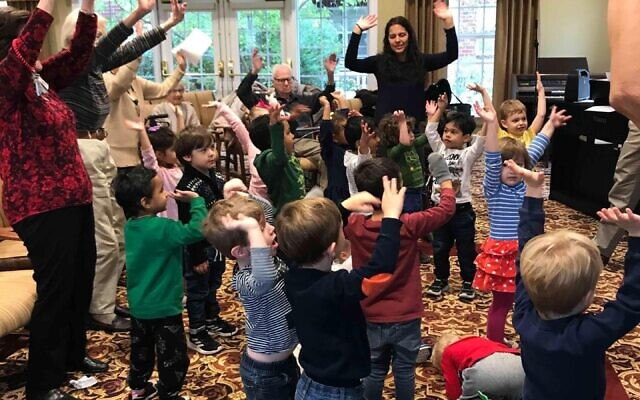 """Temple Emanuel's Early Childhood Development Center and residents at Concordia of South Hills spent time together before the COVID-19 pandemic as part of the """"Grandfriends"""" program. Photo provided by Temple Emanuel's Early Childhood Development Center."""