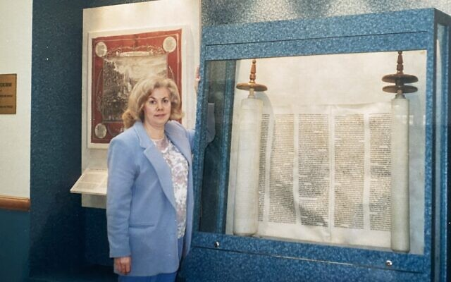 Marilyn Weinblum stands next to the case displaying Jakob's Torah at the Jewish Community Center of Greater Pittsburgh in 2001.  (Photo provided by Marilyn Weinblum)
