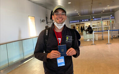 Michael Vivier, 25, shows off his new immigrant card upon arrival at Tel Aviv's Ben Gurion Airport, Sept. 2, 2020. (Courtesy of Vivier via JTA)