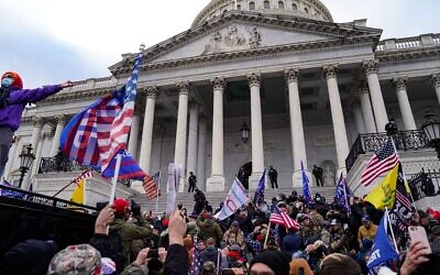 """A view of the crowds outside the U.S. Capitol for the """"Stop the Steal"""" rally on Jan. 6, 2021 that led to violence. (Robert Nickelsberg/Getty Images via JTA)"""