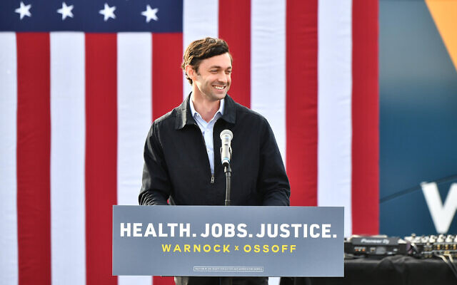 "Jon Ossoff speaks onstage during the ""Vote GA Blue"" concert for Georgia Democratic Senate candidates Raphael Warnock and Jon Ossoff on Dec. 28, 2020 in Stonecrest, Georgia. (Photo by Paras Griffin/Getty Images via JTA)"