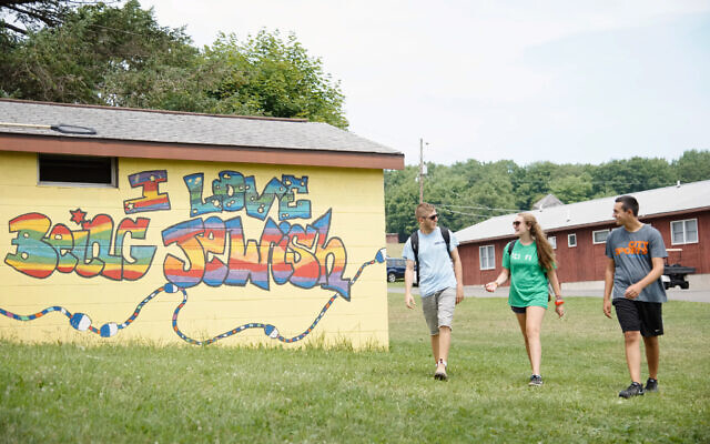 Campers and staff walk together at Camp Harlam in Kunkletown, PA. Photo courtesy of Camp Harlam
