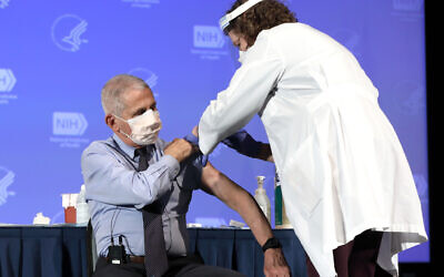 Dr. Anthony Fauci, Director of the National Institute of Allergy and Infectious Diseases, receives the Moderna COVID-19 vaccine at the HHS/NIH COVID-19 Vaccine Kick-Off event at NIH on 12/22/20. Despite the vaccinations roll out, many in Pittsburgh have struggled to find the vaccination. Credit: NIH