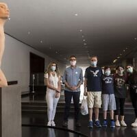Israel Museum director Ido Bruno (second from left) with visitors for a capsule tour of the museum in August 2020. (Photo courtesy Israel Museum via The Times of Israel)