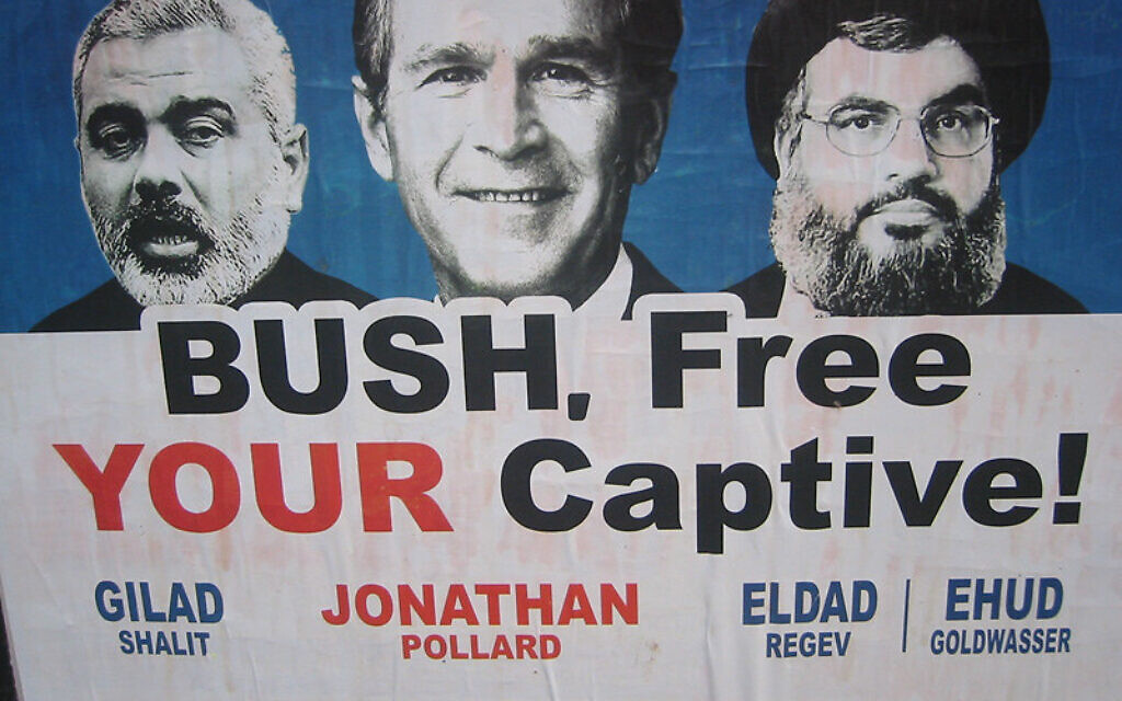When George W. Bush visited Israel, a push was made to free Jonathan Pollard. This poster compares Pollard to Gilad Shalit, Eldad Regev, and Ehud Goldwasser, three Israeli soldiers taken captive before/during the war with Lebanon.  Photo by Benjamin via Flickr.com.