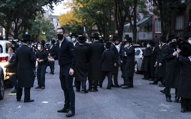 People congregate outside of Congregation Yetev Lev D'Satmar in Brooklyn, where state officials halted a planned 10,000-person wedding in October 2020. (Lev Radin/Pacific Press/LightRocket via Getty Images via JTA)