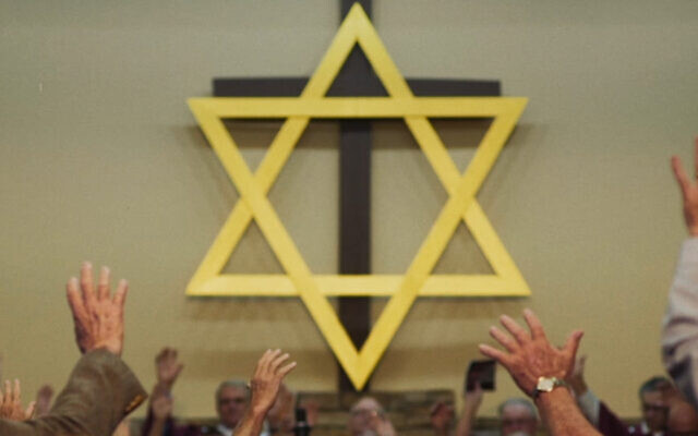 "A church in Middlesboro, Kentucky, prays to a Star of David in a still from Maya Zinshtein's documentary ""'Til Kingdom Come."" (Abraham Troen/'Til Kingdom Come (2019) Film Ltd. via JTA)"