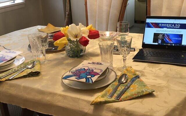 Dee Weinberg is looking forward to celebrating Passover with her family this year. Last year's seder table featured setting for Weinberg, her husband the guest of honor: a computer screen. Photo by Dee Weinberg.