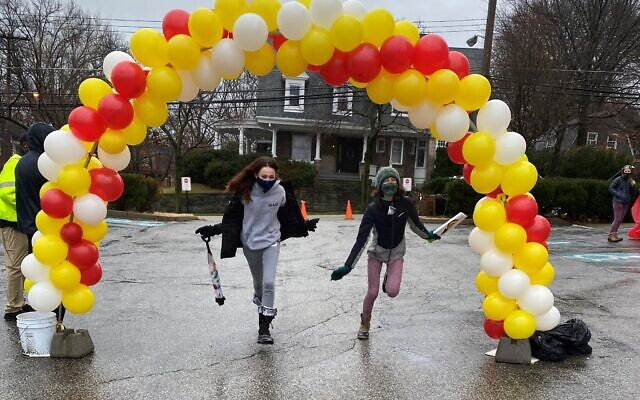 """Like other congregations, Beth Shalom has had to get creative for fundraising because of the pandemic. Earlier this year, the congregation hosted a """"Schlep-A-Thon"""" where participants circled the building, ending at a balloon decorated finish line."""