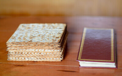 Matza and Passover Haggadah. Photo by Inna Reznik via iStockphoto.com