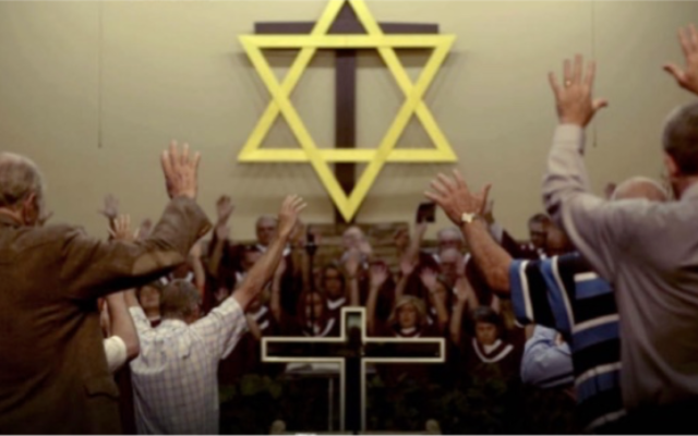 """An evangelical congregation prays in """"'Til Kingdom Come."""" (Photo by Abraham Troen)"""