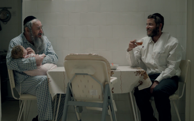 "Dovale Glickman, left, and Michael Aloni in a scene from Season 3 of ""Shtisel."" (Courtesy of Yes Studios via JTA)"