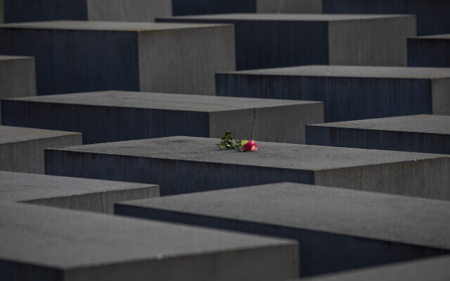 A rose is placed on the Holocaust Memorial on the International Holocaust Remembrance Day on January 27, 2021 in Berlin, Germany. (Photo by Maja Hitij/Getty Images via JTA)