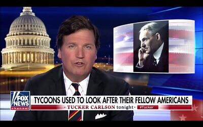 "Tucker Carlson, shown here in a 2019 segment praising the anti-Semitic Henry Ford, said Democrats are coordinating a ""replacement"" of current U.S. voters with immigrants from the ""Third World.""(Screenshot from YouTube via JTA)"