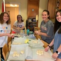 AEPhi Sisters participate in a Zoom Braid with Challah for Hunger. Photo courtesy of Kari Semel