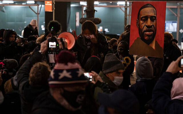 Protesters rally and march in Bryant Park, N.Y., on the first day of the trial of Minneapolis police officer Derek Chauvin, accused of killing African-American George Floyd on May 25, 2020. (Photo by Lev Radin/Shutterstock/ via JNS)
