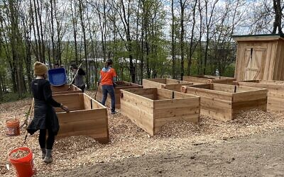 Volunteers build Sunny's Community Garden on Earth Day (Photo by Stanley Klein)