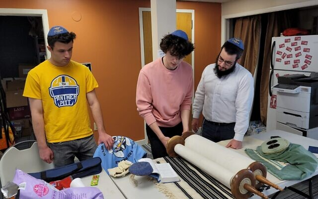 Max West, Sam Hanks and Rabbi Shmuli Rothstein do some last minute bar mitzvah training. Photo provided by Chabad House on Campus.