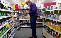 """Even among the vaccinated community, some are weary about shopping without a face covering. """"COVID-19 chronicles: man wearing a cowboy hat & a face mask."""" Photo by Gilbert Mercier, courtesy of Flickr.com"""